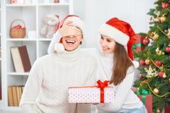 Christmas Gift. Woman Gives A Man Gift Present Box Stock Image