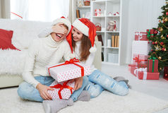 Christmas gift. woman gives a man gift present box. Christmas gift. women gives a men a surprise gift present box Royalty Free Stock Images