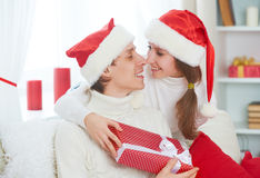 Christmas gift. woman gives a man gift present box Stock Images