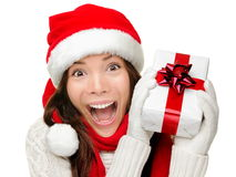 Christmas gift woman isolated. Happy excited santa woman showing christmas prensent isolated on white background Stock Photography