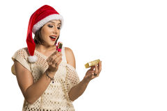 Christmas Gift - woman opening gift surprised and happy, Young b. Eautiful smiling woman in Santa hat. Funny cute photo of Brazilian / Brazilian woman in white Stock Image