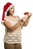 Christmas Gift - woman opening gift surprised and happy, Young b Stock Image