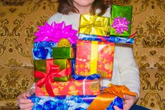 Christmas. Gift woman showing beautiful colored gift boxes. Royalty Free Stock Photos