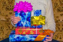 Christmas. Gift woman showing beautiful colored gift boxes. Royalty Free Stock Images