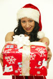 Christmas gift woman. Smiling holding present  on white background. Santa girl showing gift wearing santa hat. sute, beautiful asian model Royalty Free Stock Image
