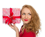 Christmas gift woman with wrapped christmas present smilling hap. Py looking at the corner isolated on a white background Stock Images