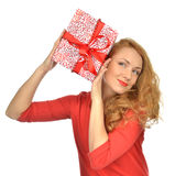 Christmas gift woman with wrapped christmas present. Smilling happy looking at the corner isolated on a white background Stock Images
