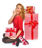 Christmas gift woman with wrapped christmas presents smiling hap. Py looking at the corner isolated on a white background Royalty Free Stock Images