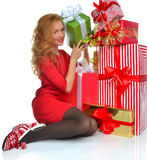 Christmas gift woman with wrapped christmas presents smilling ha. Ppy looking cameraisolated on a white background Stock Photos