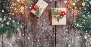 Christmas background with Christmas gift on wooden background with Fir branches. Xmas and Happy New Year composition. Flat lay, top view royalty free stock images