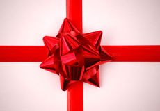 Christmas Gift Wrap. Red ribbons and a red bow stock image