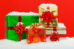 Christmas gift wrapped presents red background. Stock Images