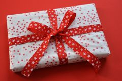 Beautifully wrapped Christmas gift with a red bow royalty free stock image