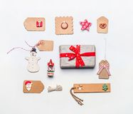 Christmas gift wrapping concept. Flat lay of various craft eco paper cardboard package and tags with vintage decoration. On white desktop background, top view Stock Photo