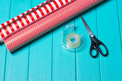 Christmas Gift Wrapping Party Time with Colorful Paper, Ribbon Bows, Scissors a Royalty Free Stock Photography