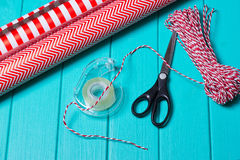 Christmas Gift Wrapping Party Time with Colorful Paper, Ribbon Bows, Scissors a Royalty Free Stock Photo