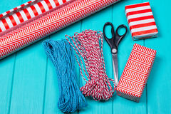 Christmas Gift Wrapping Party Time with Colorful Paper, Ribbon Bows, Scissors a Stock Photo
