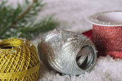 Christmas gift wrapping ribbons. In gold, silver and red on white snow Royalty Free Stock Photo