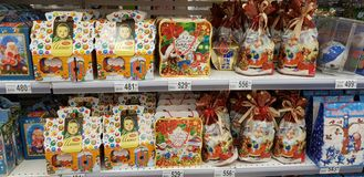 Christmas gift wrapping with sweets in the supermarket stock images