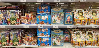 Christmas gift wrapping with sweets in the supermarket stock image