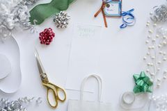 Christmas gift for christmas with wrappings. Gift ideas with Wrappings from top view for christmas gift including ribbon and scissors Stock Photo