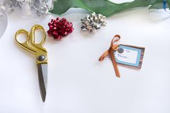Christmas gift for christmas with wrappings. Wrappings from top view for christmas gift including ribbon and scissors Stock Images