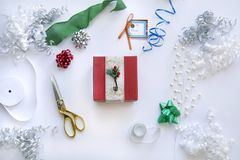Christmas gift for christmas with wrappings. Wrappings from top view for christmas gift including ribbon, tape and scissors Royalty Free Stock Image