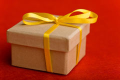 Christmas gift with yellow bow Stock Photos