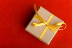Christmas gift with yellow bow from Royalty Free Stock Photo