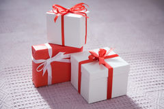 Christmas gifts. Three different beautiful gifts lie on a floor Stock Images