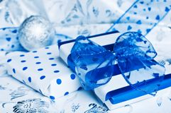 Christmas gifts. Blue and white on silver Royalty Free Stock Photography