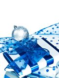 Christmas gifts. Christmas blue and white gifts and silver ball Royalty Free Stock Photography