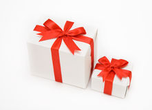 Christmas gifts. Isolated beautiful white gifts are tied up by a red tape Stock Photos