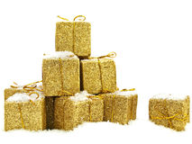 Christmas gifts. Some golden christmas gifts under the snow Stock Image