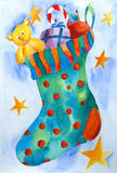 Christmas Gifts. Sock with toys and candy, watercolor painting, created and painted by the photographer Royalty Free Stock Images