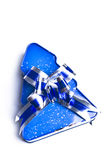 Christmas gifts. With blue metalic ribbon on White Stock Photos