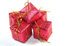 Christmas gifts. Red with a golden ribbon royalty free stock images