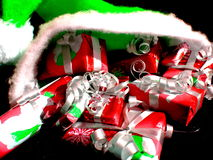Christmas gifts. Green Christmas hat filled with wrapped gifts Royalty Free Stock Photo