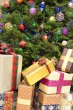 Christmas gifts. Christmas tree with many colorful gifts Royalty Free Stock Images