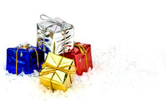 Christmas gifts. A pile of christmas gifts on a white snowy background Royalty Free Stock Photos