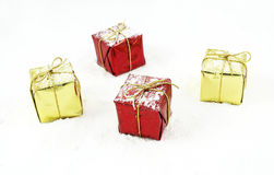 Christmas gifts. In the snow Royalty Free Stock Images