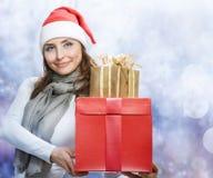 Christmas Gifts. Beautiful Santa Girl with Christmas Holidays Gifts Stock Image