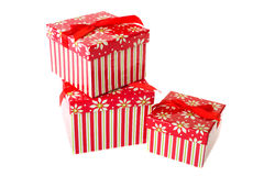 Christmas gifts. Colorful decorated red Christmas gifts isolated over white Royalty Free Stock Photos