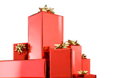Christmas gifts. Christmas presents with golden bows isolated over white background Royalty Free Stock Photo