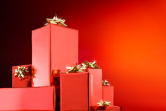 Christmas gifts. Christmas presents with golden bows over red background Royalty Free Stock Photo