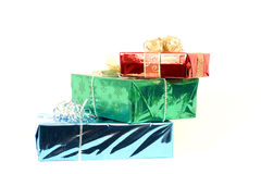 Christmas gifts. 3 xmas gifts piled on a white background Royalty Free Stock Images