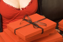 Christmas Gifts. A stack of red gift boxes, the top one tied with black ribbon royalty free stock photos