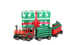 Christmas Gifts. Christmas Gift and toy train against a white background Stock Photos