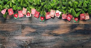 Christmas gifts Advent calendar wooden background. Christmas gifts Advent calendar on wooden background stock photography