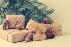 Christmas gifts against green fir branches. Stock Image